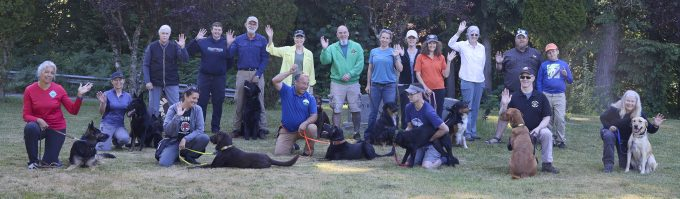 Group picture of attendees and their dogs